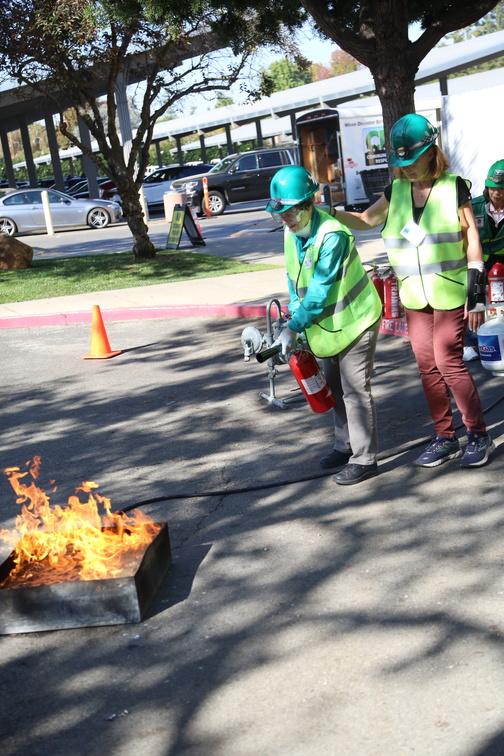 Los Altos resident Agnes Caufield practices using a fire extinguisher