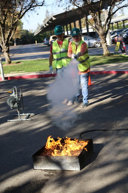 CERT trainees practice using a fire extinguisher